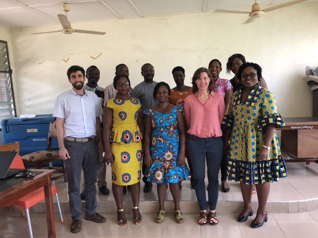 Health district office staff pose with program staff in Ho, Ghana.