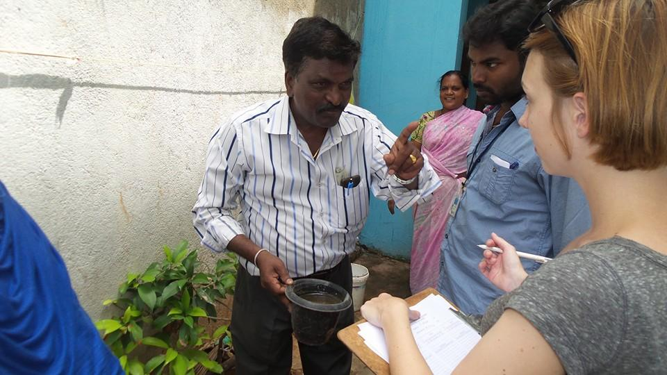 Student and Preceptor outside a home in Pudicherry, India discussing mosquito breeding sites with local residents.