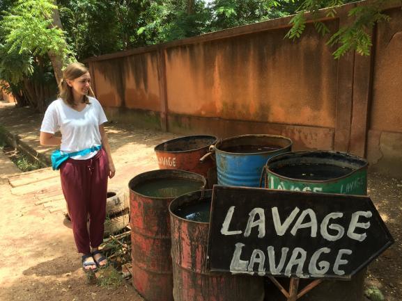 Blythe observing the wash facilities in  Ouagadougou.