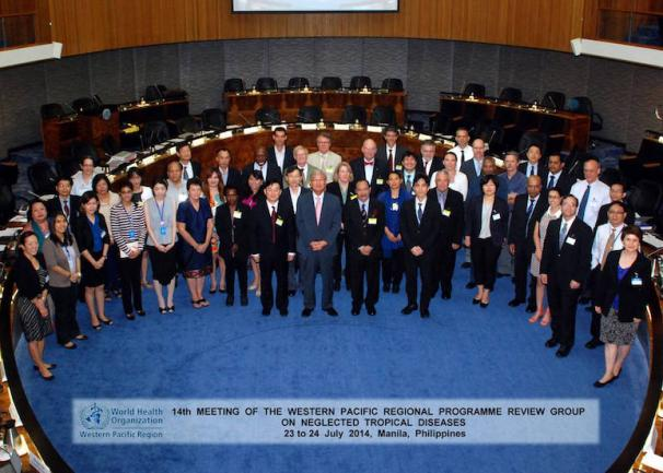 Attendees of a WHO conference on neglected tropical diseases pose for a group photo in Manila.